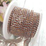 Стразовая лента с коричневыми кристаллами в серебряной оправе, 2 мм