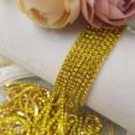 Стразовая лента с желтыми кристаллами в золотой оправе, 2 мм
