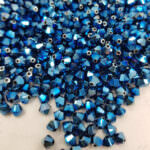 5328 Биконус Swarovski (бусины Xilion), Crystal Metallic Blue Shimmer 2X, 10 шт.